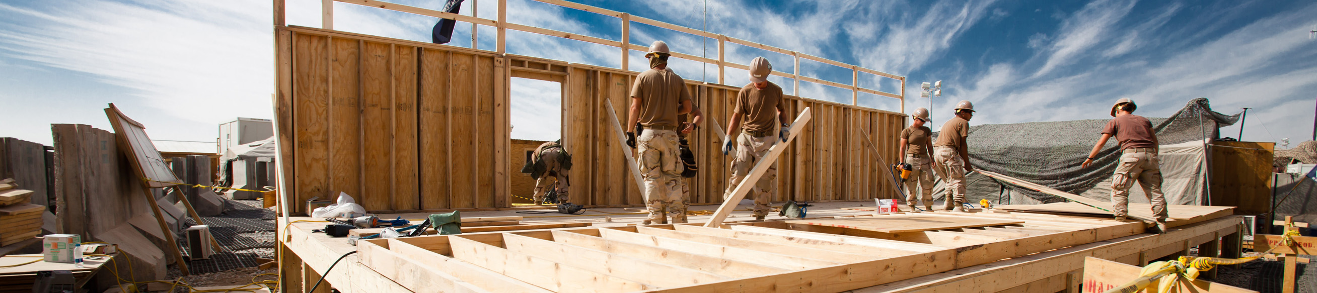 slim_US_Navy_101104-N-6383T-507_Seabees_assigned_to_Naval_Mobile_Construction_Battalion_NMCB_18_build_a_Southwest_Asian_Hut_at_Kandahar_Air_Field